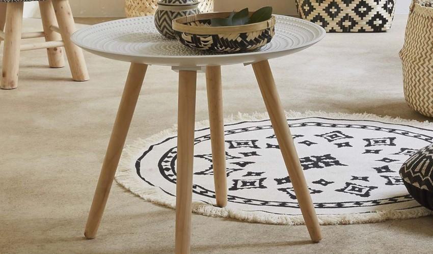table basse ronde et son plateau blanc incurvé