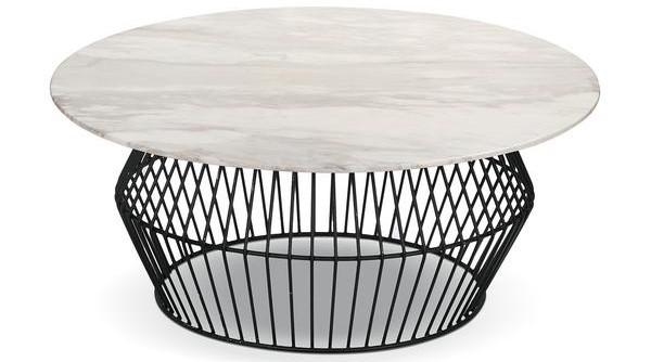 table basse ronde avec un grand plateau blanc et des pieds en fer rappelant le rotin